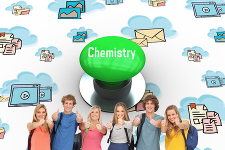 green chemistry: The word chemistry and smiling group giving a thumbs up as they wear backpacks against digitally generated green push button