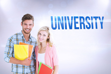 university word: The word university and happy students smiling at camera  against grey background Stock Photo