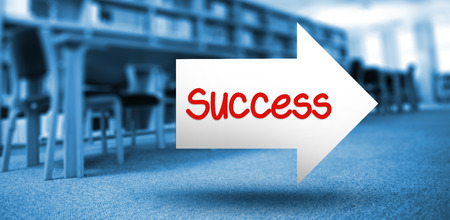 volumes: The word success and arrow against volumes of books on bookshelf in library Stock Photo