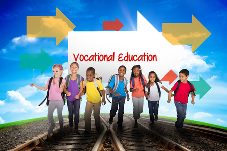vocational: The word vocational education and elementary pupils running against railway leading to blue sky