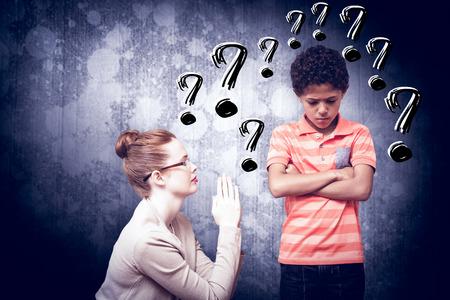 angry teacher: Teacher begging boy against dark grey room