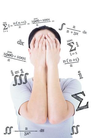 matematicas: Mujer triste que oculta su rostro contra ecuaci�n matem�tica Foto de archivo