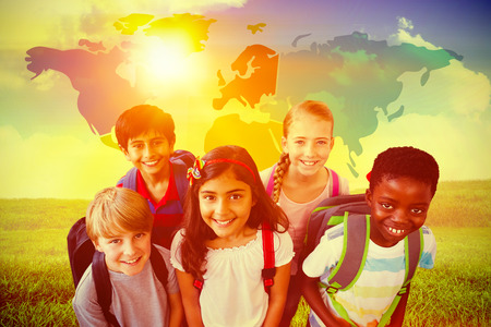 indian student: Smiling little school kids in school corridor against green field under blue sky Stock Photo