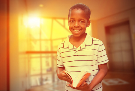 foyer: happy pupil with book against foyer area with elevator Stock Photo