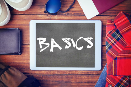 basics: The word basics and differents objects using every days against black wall