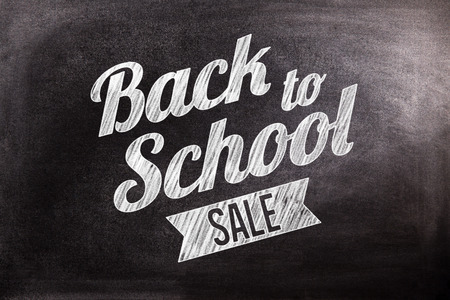 sales person: Back to school sale message against black background
