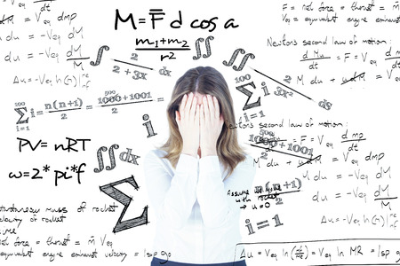 anxiety: Anxious businesswoman with head in hands against maths equation