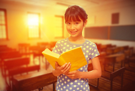the pupil: happy pupil against empty classroom