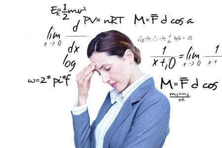 concentrating: Concentrating businesswoman against maths equation