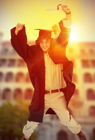 academic robe: Composite image of male student in graduate robe jumping Stock Photo