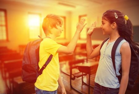 School kids against empty classroom