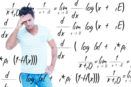 equation: Concentrating man against maths equation Stock Photo