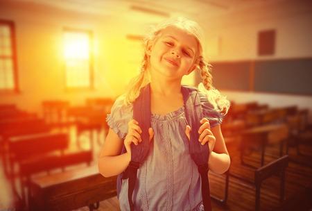 empty classroom: School kid against empty classroom Stock Photo