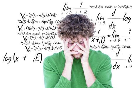 matematicas: Ansioso casual mirando a la cámara contra ecuación matemática Foto de archivo