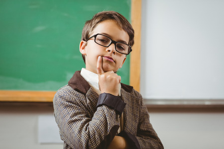 Portrait of pupil dressed up as teacher thinking in a classroom Stok Fotoğraf - 43914827