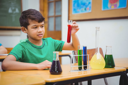 science lesson: Student using lab glassware at the elementary school