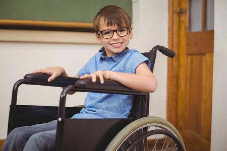 paraplegic: Disabled pupil smiling at camera at the elementary school Foto de archivo