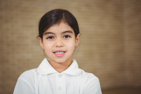school uniform: Happy pupil looking at the camera at the elementary school