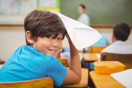 throw paper: Pupil about to throw paper airplane at the elementary school