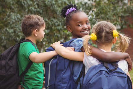 black kid: Smiling students looking at the camera on the elementary school grounds Stock Photo
