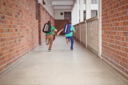 Students running down the school hall on the elementary school grounds