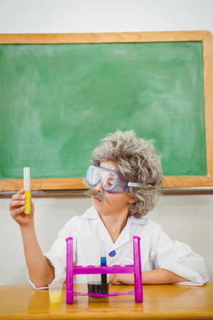 make believe: Student dressed up as einstein using a chemistry set at the elementary school