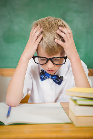 frustrated student: Frustrated student reading books at the elementary school
