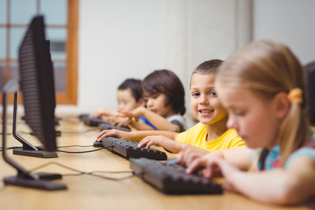 computer class: Cute pupils in computer class at the elementary school