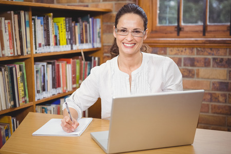 school teacher: Teacher using her laptop for work at the elementary school