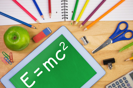 relativity: Theory of relativity against students table with school supplies