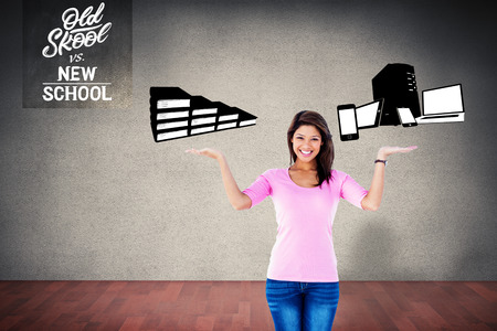 versus: Pretty brunette showing something with her hands against old school versus new school Stock Photo