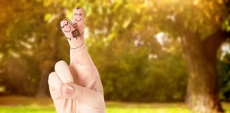 freedom nature: Fingers posed as students against trees and meadow in the park Stock Photo
