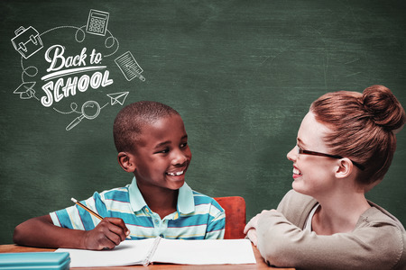 the pupil: Happy pupil and teacher against green chalkboard