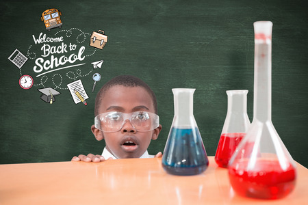 make believe: Pupil doing science experiment against green chalkboard