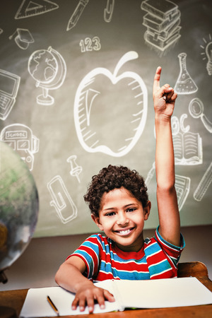 classroom: Education doodles against little boy raising hand in classroom Stock Photo