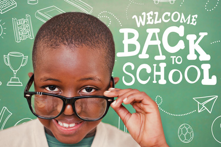 tilting: Cute pupil tilting glasses against back to school Stock Photo