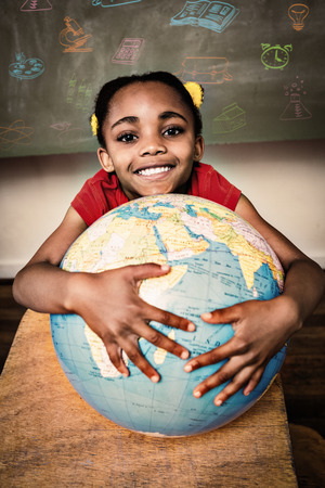 child education: School subjects doodles against cute little girl holding globe