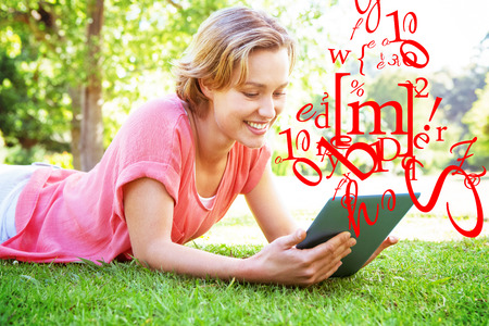 jumble: letter and number jumble against pretty woman using tablet in park