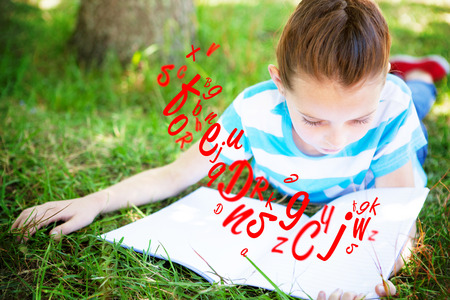 jumble: letter and number jumble against cute little girl reading in park