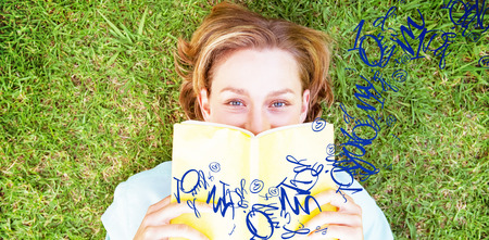 jumble: letter and number jumble against pretty woman reading book in park Stock Photo