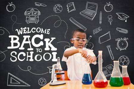 make believe: Cute pupil playing scientist against blackboard