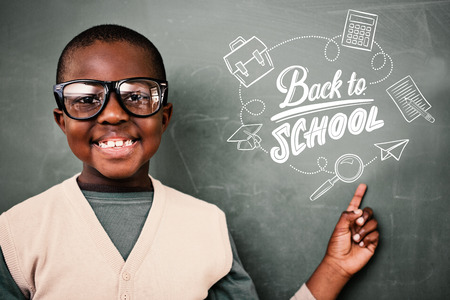 pupil: Cute pupil pointing against back to school