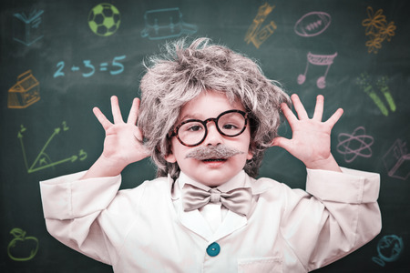 dressed up: School subjects doodles against cute dressed up pupil showing his hands Stock Photo