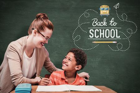 pupil: Teacher helping pupil against green chalkboard