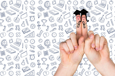 posed: Fingers posed as students against school wallpaper Stock Photo