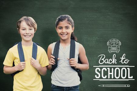School kids against green chalkboard Stock Photo