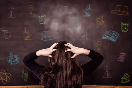School subjects doodles against confused pupil looking at chalkboard Stock Photo