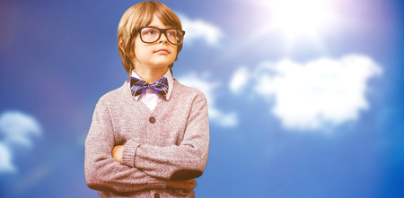 make believe: Cute pupil dressed up as teacher against bright blue sky with clouds