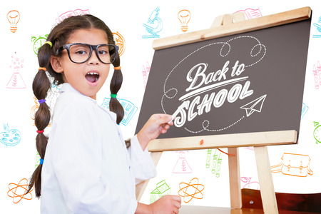 science text: Cute pupil with chalkboard against back to school Stock Photo