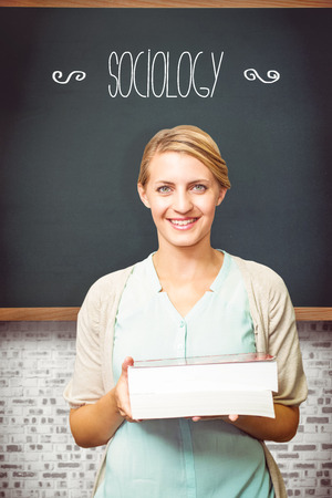 sociology: The word sociology and smiling student against teal Stock Photo